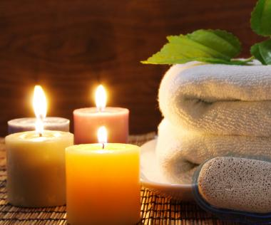 Towel, aromatic candles and other spa objects